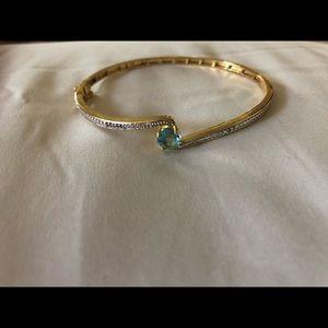 Gold and blue gem bracelet